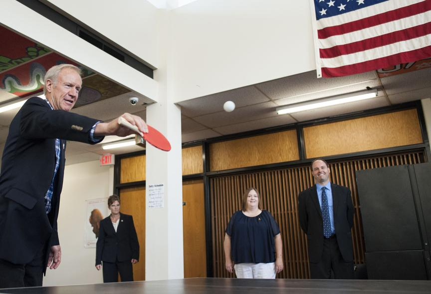 Gov. Bruce Rauner plays a round of pingpong Friday, Aug. 26, 2016, during his visit to Carbondale High School's Rebound program. (Ryan Michalesko | @photosbylesko)