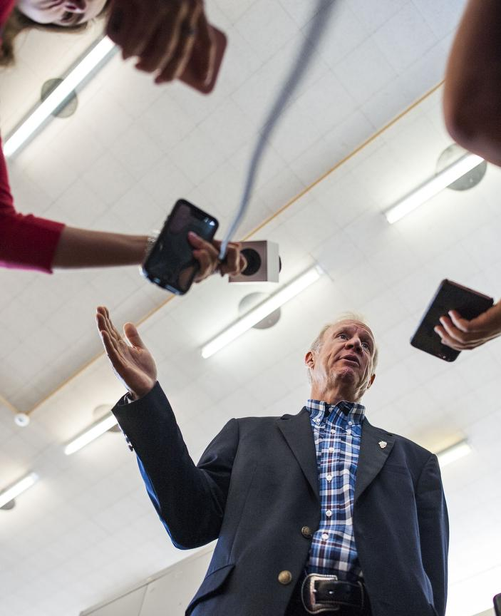 Gov. Bruce Rauner speaks with members of the media Friday, Aug. 26, 2016, following his visit to Carbondale High School's Rebound program. (Ryan Michalesko | @photosbylesko)