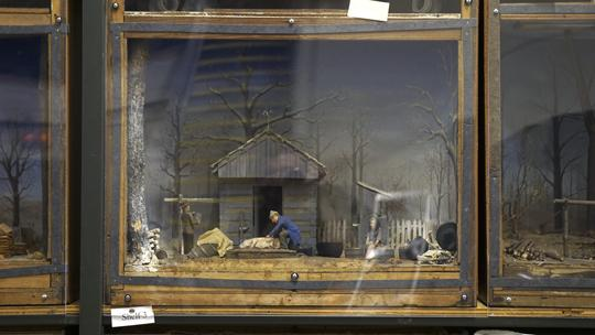 A hog-butchering in pioneer times in southern Illinois is depicted in a diorama by veteran Frederic Arnold Holder, Thursday, Aug. 25, 2016 in the University Museum's archives warehouse. Holder, a Carbondale native, worked on dioramas during the Works Progress Administration Museum Project until he left for World War II in 1941. (Andy Phillippe | @andyphillippede)