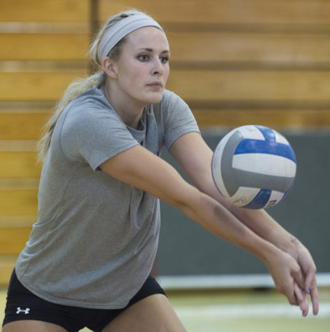 Junior middle hitter Alex Rosignol digs a shot during volleyball practice Monday, Aug. 29, 2016, in Davies Gym. (Ryan Michalesko | @photosbylesko)