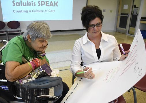 Ann DeHorn, of Carbondale, discusses what care means to her with assistant dean of students Deborah Barnett on Tuesday, Aug. 30, 2016, during the Salukis SPEAK forum in the Student Services Building. (Athena Chrysanthou | @Chrysant1Athena)