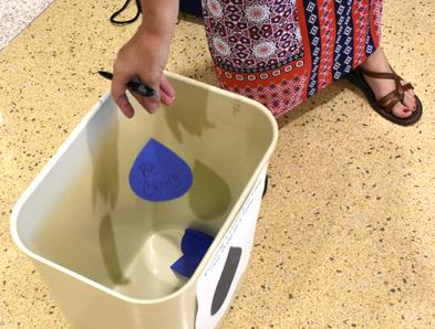 Assistant dean of students Deborah Barnett throws a teardrop-shaped cutout into a bucket Tuesday, Aug. 30, 2016, during the Salukis SPEAK forum in the Student Services Building. (Athena Chrysanthou   @Chrysant1Athena)