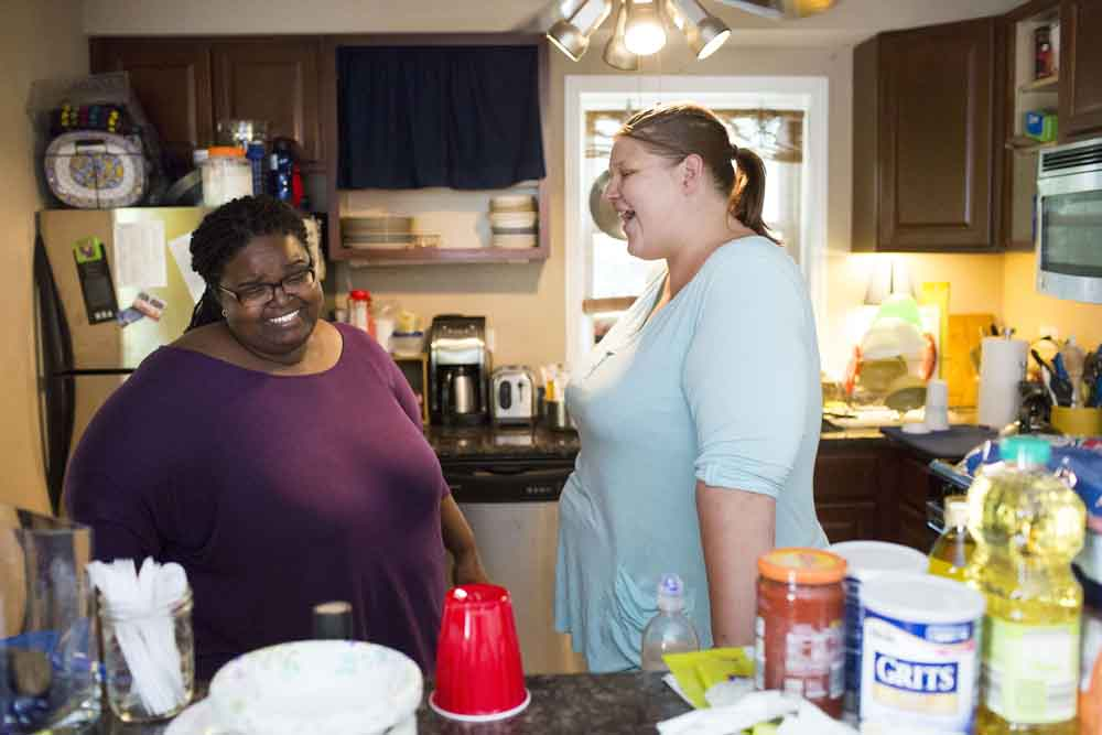 From left, Dawnn Pirani-Brumfield, 38, and her wife Rachel Pirani-Brumfield, 37, laugh at each other while unpacking groceries in their home Tuesday, July 26, 2016, in Chicago. (Armando L. Sanchez/Chicago Tribune/TNS)