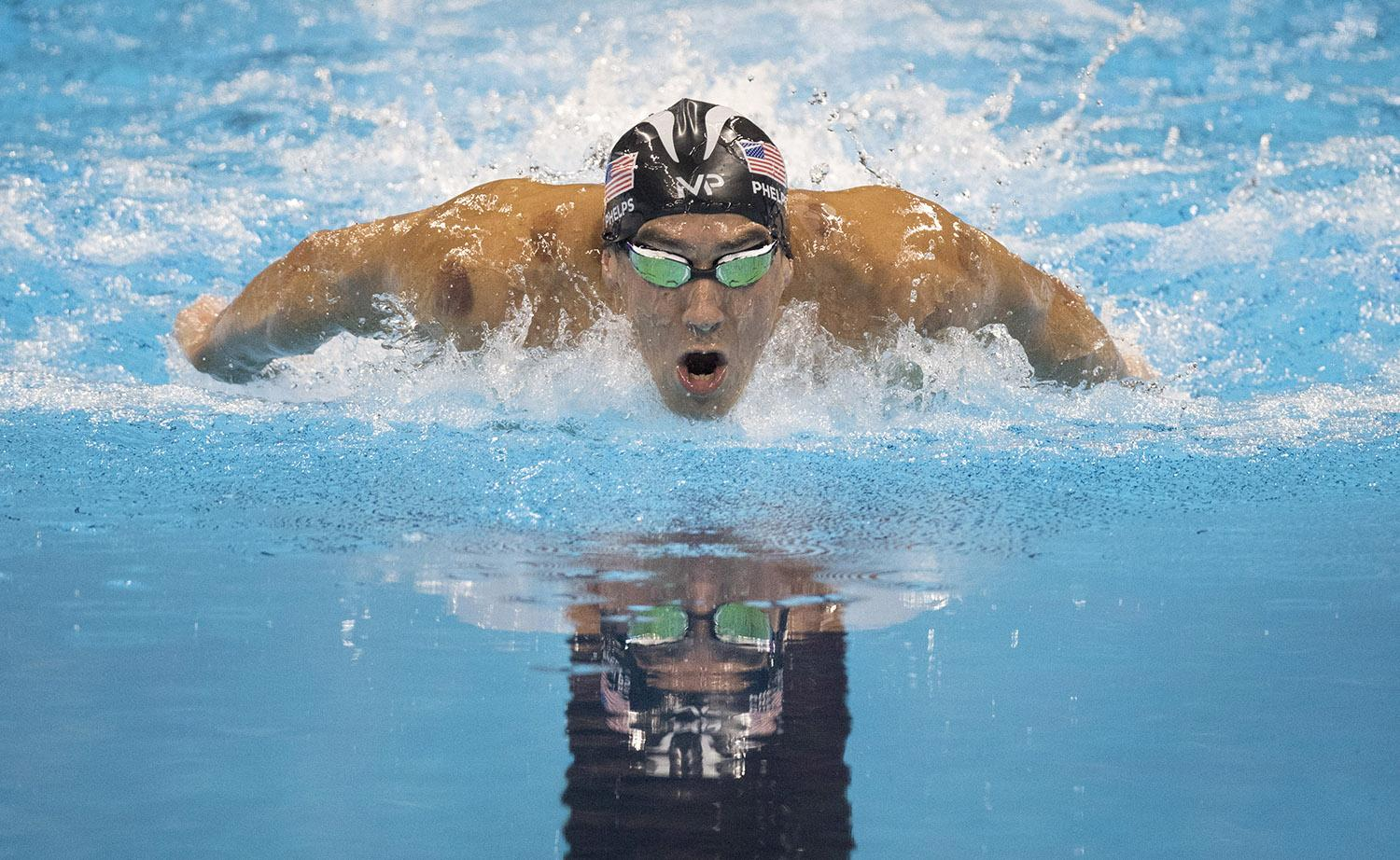 U.S. swimmer Michael Phelps swims to a gold medal in the men's 200m Butterfly at the Olympic Aquatic Stadium in Rio de Janeiro, Brazil, on Tuesday, Aug. 9, 2016. (Mark Reis/Colorado Springs Gazette/TNS)