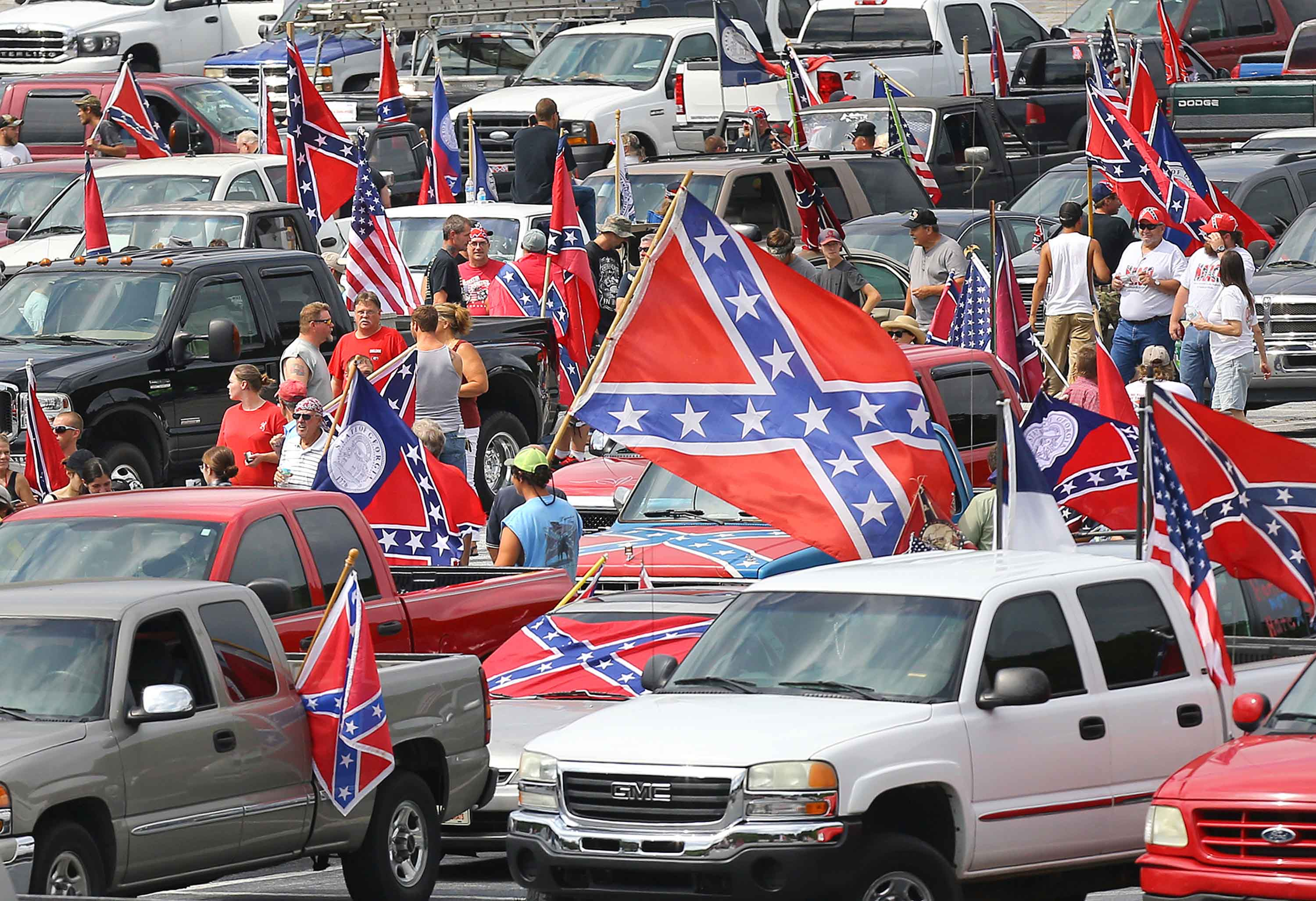Hundreds of pro-Confederate flag and gun supporters rally at Stone Mountain Park on Saturday, Aug. 1, 2015, in Stone Mountain, Ga. (Curtis Compton/Atlanta Journal-Constitution/TNS)