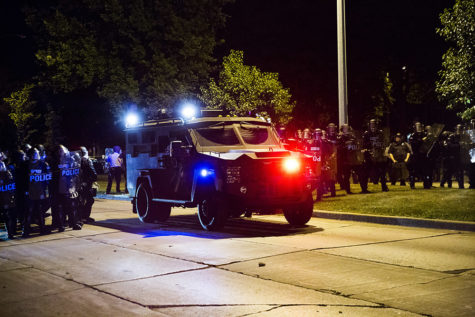 An armored vehicle positions itself to protect law enforcement after rocks and bottles were thrown by rioters during protests following a fatal police involved shooting the day before Sunday in Milwaukee, Wis. (Armando L. Sanchez/Chicago Tribune/TNS)