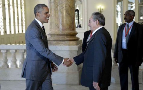 U.S. President Barack Obama and Cuban President Raul Castro shake hands before delivering remarks on March 22, 2016, in Havana, Cuba. The Cubans are now stepping up their efforts to blunt the Cuban Adjustment Act. (Olivier Douliery/Abaca Press/TNS)
