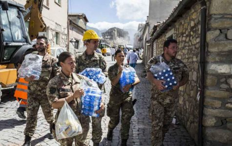 Responders carry water and supplies following an earthquake in Amatrice, central Italy on Aug. 24, 2016. At least 39 people have died, according to CNN affiliate Rai. (Roma/Rex Shutterstock/Zuma Press/TNS)