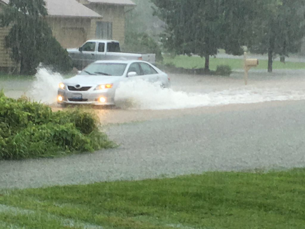 A car drives through standing water Saturday morning on Meadowlark Drive in Carterville. (Gary Spoerre for DailyEgyptian.com)