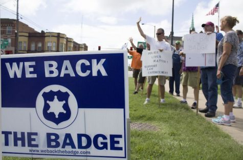 People gather Monday for a Blue Lives Matter rally near the pavilion in downtown Carbondale. (Isabel Miller for dailyegyptian.com)