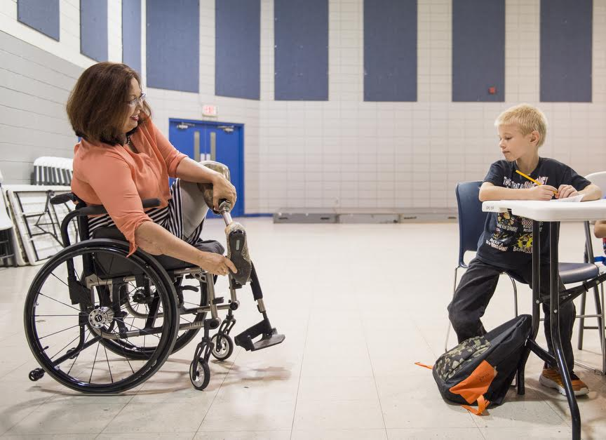 U.S. Rep. Tammy Duckworth, left, jokes with a student in the Eurma C. Hayes Center after school program on Friday, Aug. 26, 2016, in Carbondale.