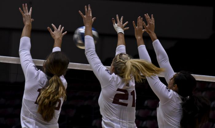 Left to right: Junior outside hitter Abby Barrow, junior middle hitter Alex Rosignol and senior setter/hitter Meg Viggars jump for the ball during the Salukis' 3-2 win over Central Florida on Friday, Sept. 2, 2016, at SIU Arena. (Autumn Suyko | @AutumnSuyko_DE)