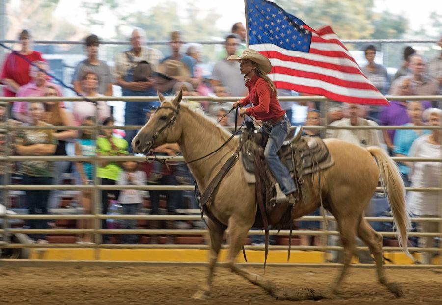 Eleven-year-old+Karley+Jones%2C+of+Thompsonville%2C+rides+around+the+horse+arena+carrying+an+American+Flag+prior+to+the+playing+of+The+Star-Spangled+Banner+on+Saturday%2C+Sept.+3%2C+2016%2C+during+the+Du+Quoin+State+Fair+rodeo.+%28Jacob+Wiegand+%7C+%40JacobWiegand_DE%29