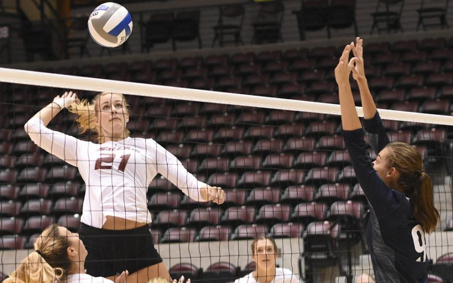 Junior middle hitter Alex Rosignol goes for a kill Saturday, Sept. 3, 2016, during SIU's 3-1 loss to Northern Arizona at SIU Arena. (Sean Carley | @SCarleyDE)