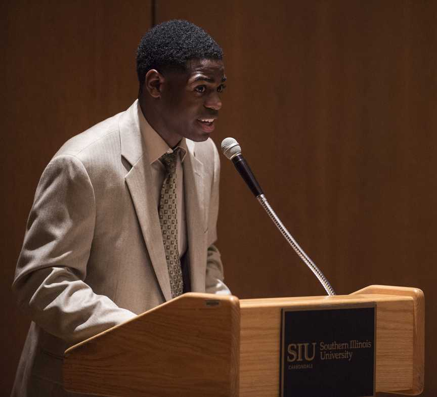 SIU College Democrats President Travis Washington, a senior from Homewood studying speech communication, introduces C.J. Baricevic, an SIU School of Law alumnus and 12th US Congressional District candidate, Wednesday, Sept. 7, 2016, during a College Democrats meeting in the Student Center. (Ryan Michalesko | @photosbylesko)