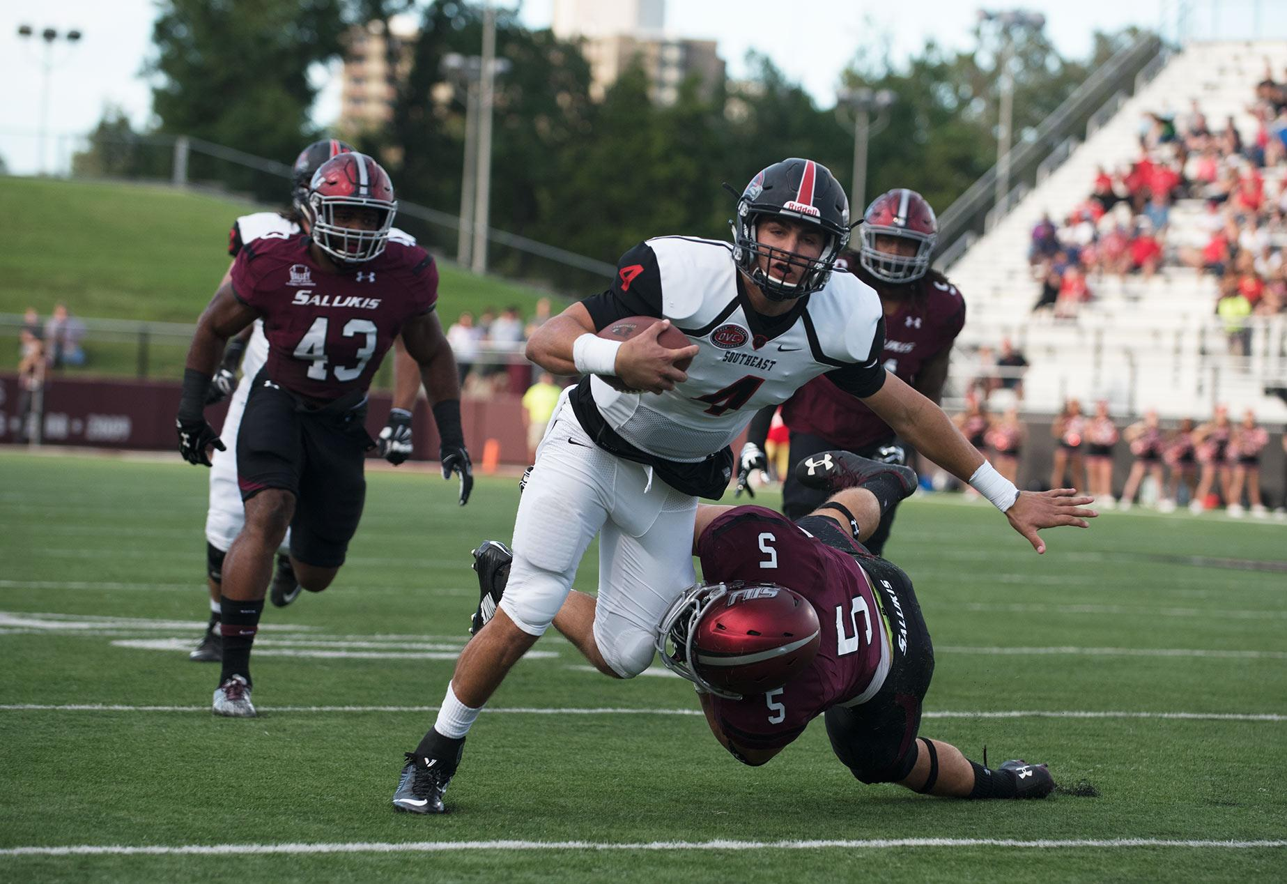 Saluki senior linebacker Chase Allen tackles SEMO junior quarterback Jesse Hosket during the first half of the Salukis' matchup against the Redhawks on Saturday, Sept. 10, 2016, at Saluki Stadium. (Jacob Wiegand | @JacobWiegand_DE)