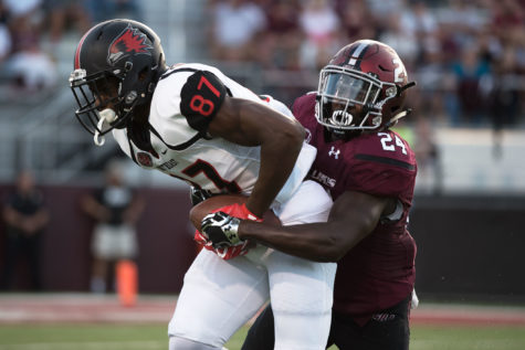 Saluki sophomore safety Jefferson Vea tackles SEMO redshirt freshman wide receiver Kristian Wilkerson during the first half of the Salukis' matchup against the Redhawks on Saturday, Sept. 10, 2016, at Saluki Stadium. (Jacob Wiegand | @JacobWiegand_DE)