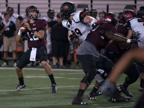 Senior quarterback Josh Straughan prepares to throw the ball during the first half of SIU's 30-22 win against the Redhawks on Saturday, Sept. 10, 2016, at Saluki Stadium. (Jacob Wiegand | @JacobWiegand_DE)