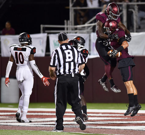 Sophomore wide receiver Darrell James and junior wide receiver Connor Iwema celebrate a touchdown in the third quarter of SIU's 30-22 win against Southeast Missouri on Saturday, Sept. 10, 2016, at Saluki Stadium. (Morgan Timms | @Morgan_Timms)