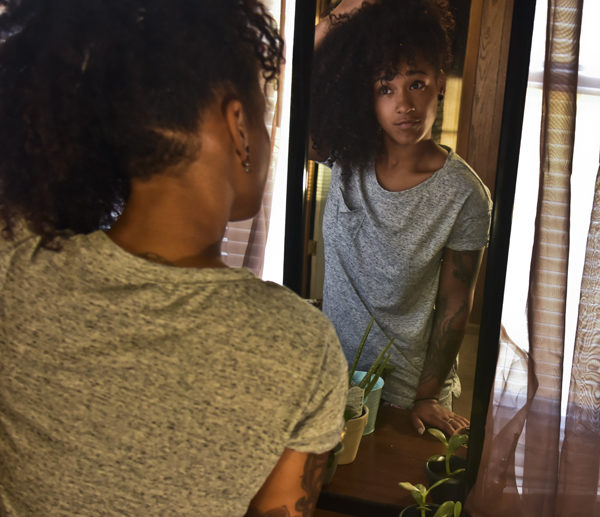 Ciara Nixon, a junior from Danville studying forestry and environmental sciences, styles her hair Sunday, Sept. 11, 2016, at her house in Carbondale.