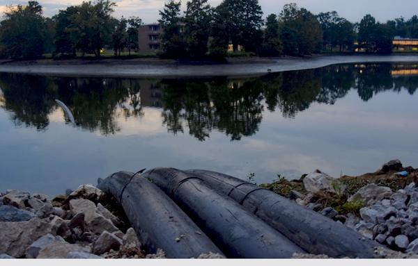 Pipes used to drain Campus Lake are seen Thursday, Sept. 15, 2016, near Thompson Point. (Autumn Suyko |@AutumnSuyko_DE)