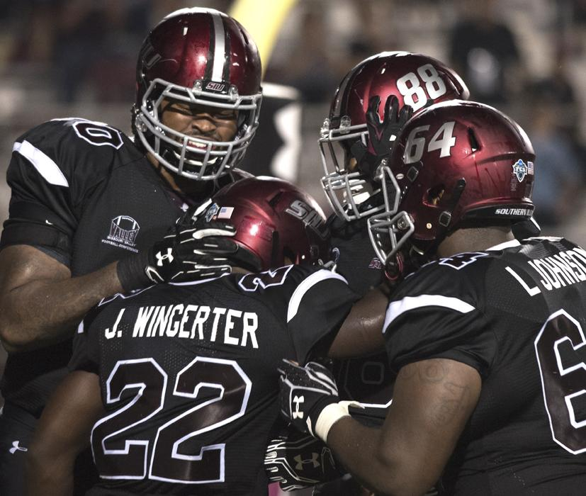 Salukis+celebrate+a+touchdown+by+junior+running+back+Cameron+Walter+%2822%29+during+SIU%27s+50-17+win+against+Murray+State+on+Saturday%2C+Sept.+17%2C+2016%2C+at+Saluki+Stadium.+%28Anna+Spoerre+%7C+%40annaspoerre%29