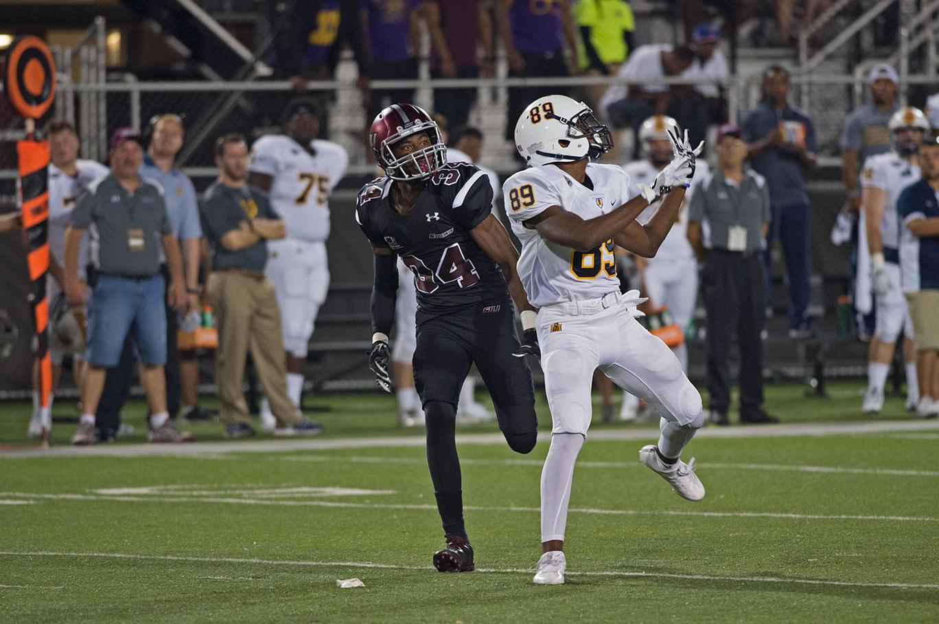 Saluki redshirt freshman cornerback Kerwin McElvaney runs down the field near Racer freshman wide receiver Jonathan Moss during SIU's 50-17 win against Murray State on Saturday, Sept. 17, 2016, at Saluki Stadium. (Jacob Wiegand | @JacobWiegand_DE)