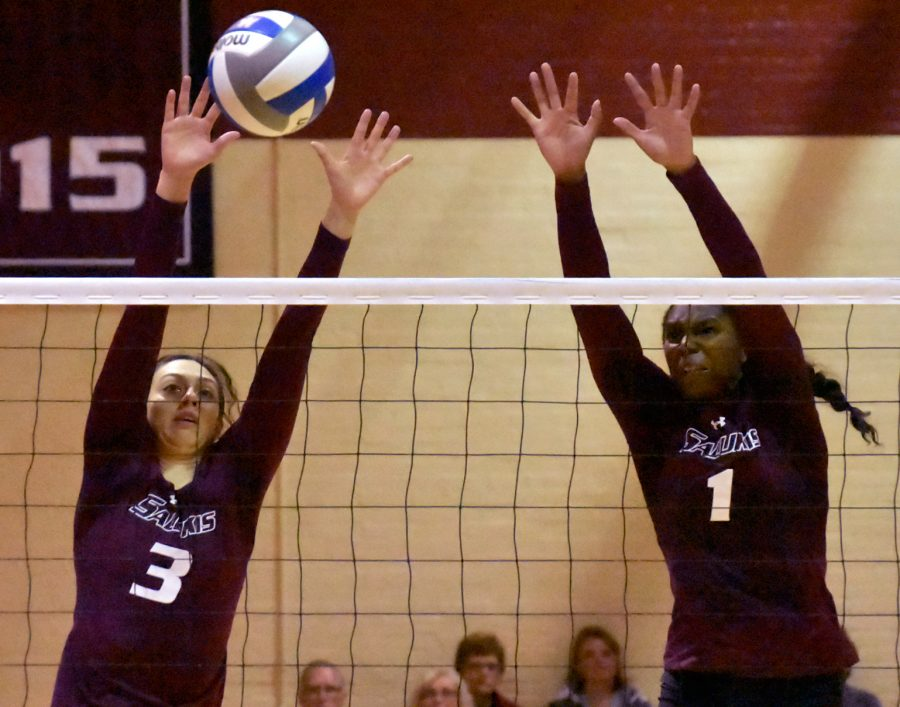 Senior hitter Meg Viggars, left, and junior middle hitter Kolby Meeks go for a block during SIU's 3-1 victory over the Drake Bulldogs on Saturday, Sept. 24, 2016, at Davies Gym (Sean Carley | @SCarleyDE)