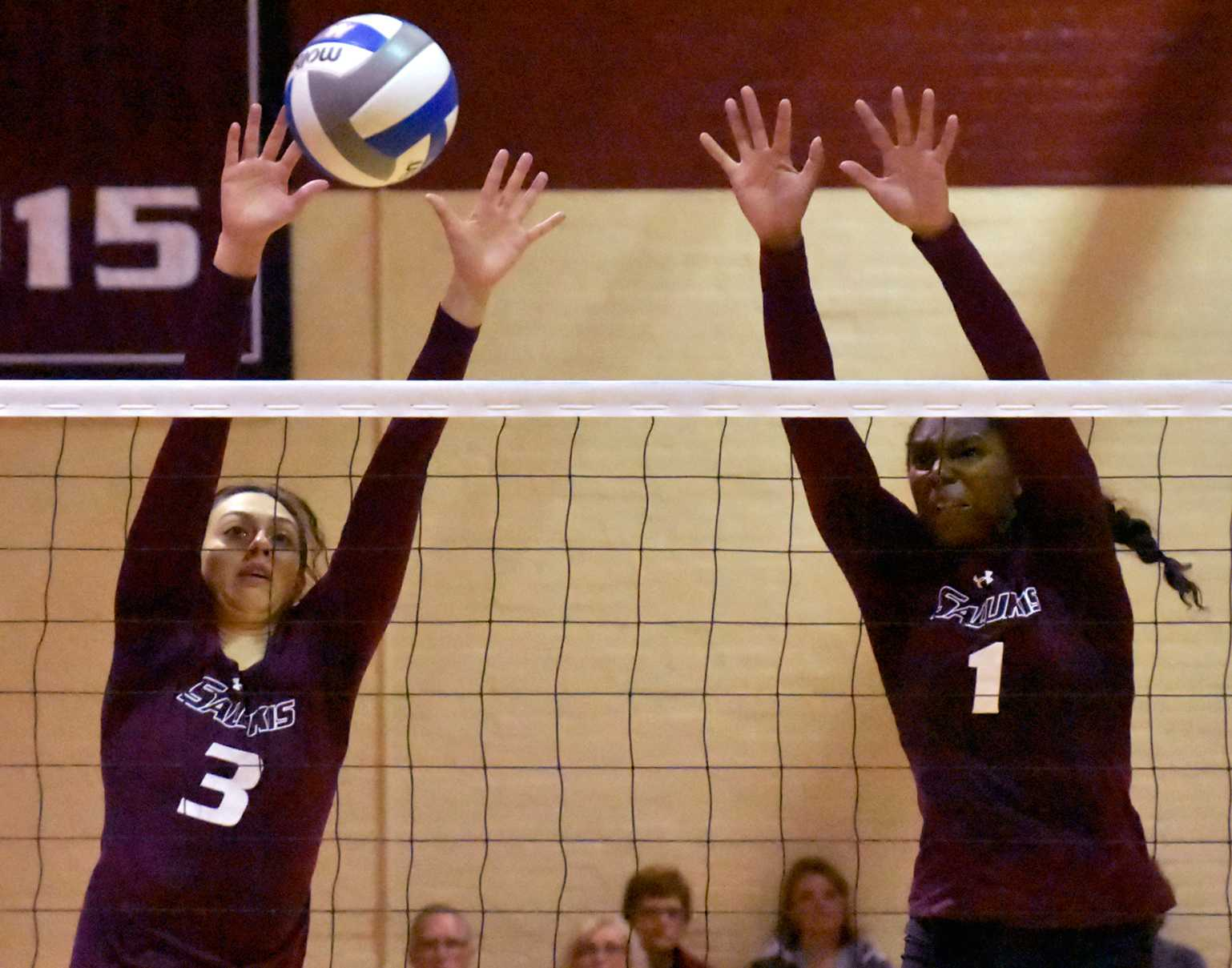 Senior hitter Meg Viggars, left, and junior middle hitter Kolby Meeks go for a block during SIU's 3-1 victory over the Drake Bulldogs on Saturday, Sept. 24, 2016, at Davies Gym (Sean Carley   @SCarleyDE)
