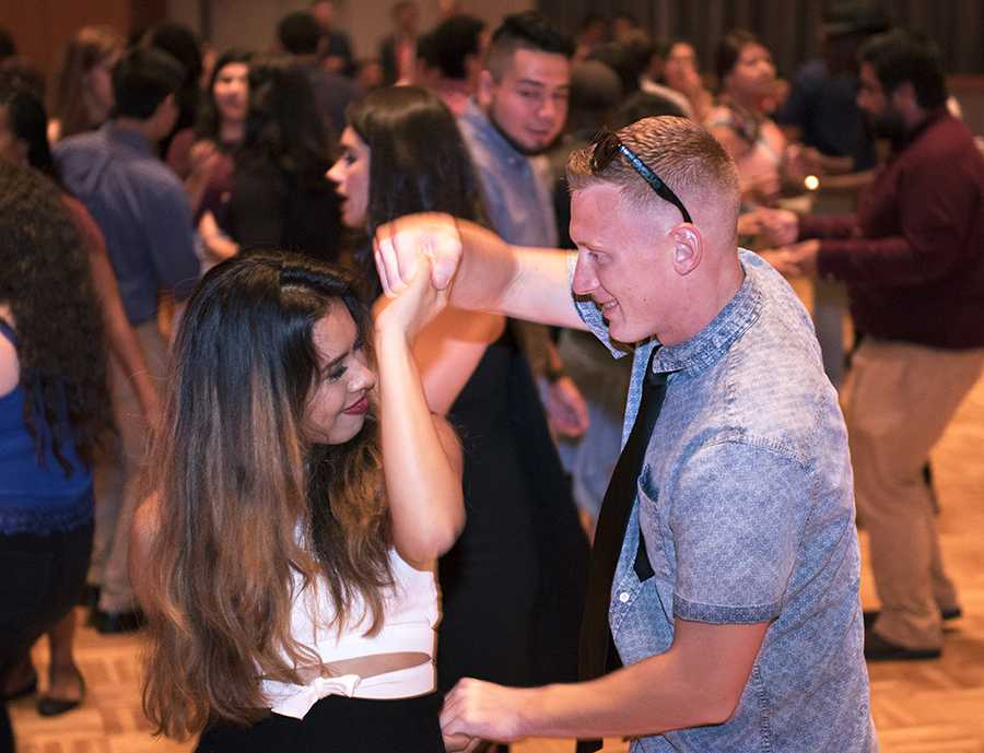 Gissell Obregon, a freshman from Fort Worth, Texas, studying radiological sciences, dances with her boyfriend of one week, Kaleb Green-Light, an undeclared freshman from Carbondale, on Saturday, Sept. 24, 2016, during SIU's Noche de Gala event at the Student Center ballrooms. (Morgan Timms | @Morgan_Timms)