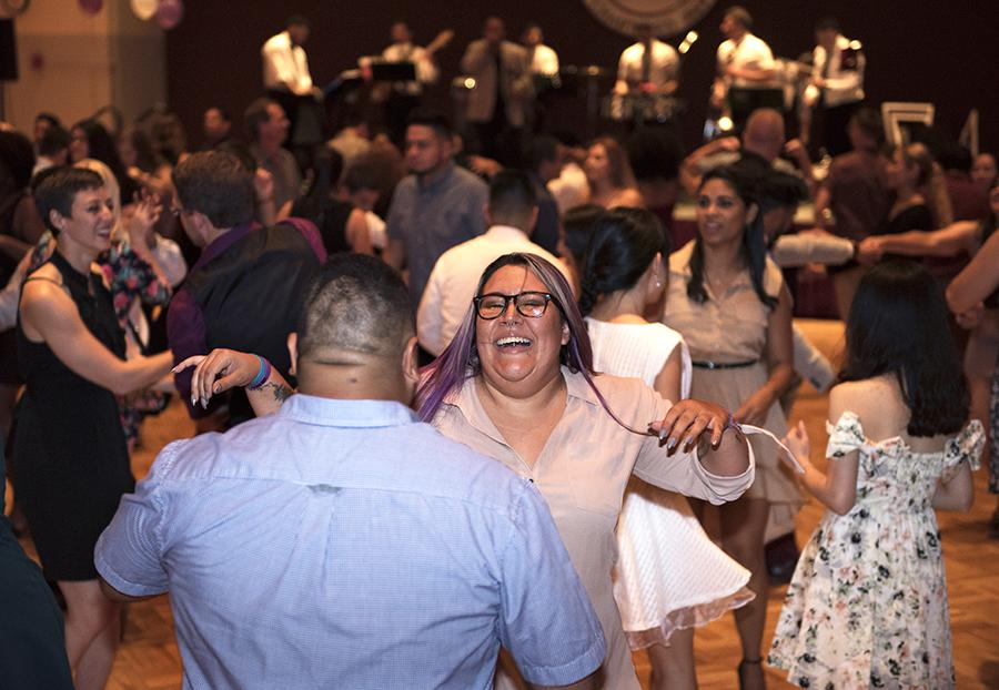 Amalia Acuña, originally from Santiago, Panama, dances with Pedro Vazquez, of Humacao, Puerto Rico, on Saturday, Sept. 24, 2016, during SIU's Noche de Gala event at the Student Center ballrooms. (Morgan Timms | @Morgan_Timms)