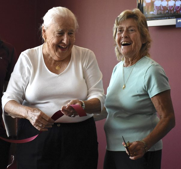 Retired SIU associate athletic director Charlotte West, left, and former women's tennis coach Judy Auld cut a ribbon during a locker room dedication ceremony Saturday, Sept. 24, 2016, at SIU Arena. (Athena Chrysanthou | @Chrysant1Athena)
