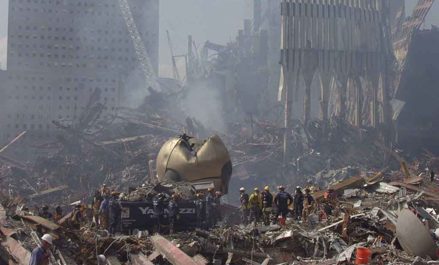 Rescue crews work to clear debris from the site of the World Trade Center near the