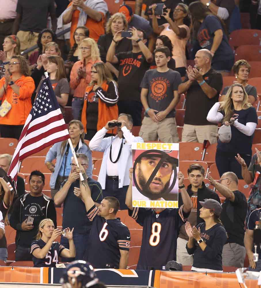 Chicago Bears fans make their views of San Francisco 49ers quarterback Colin Kaepernick known during the playing of the national anthem before a pre-season game against the Cleveland Browns on Thursday, Sept. 1, 2016, at FirstEnergy Stadium in Cleveland. (Phil Masturzo/Akron Beacon Journal/TNS)