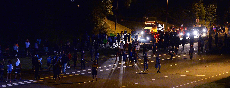 Protestors walk down Harris Blvd. on Wednesday morning, Sept. 21, 2016 in Charlotte, N.C. (Jeff Siner/Charlotte Observer/TNS)