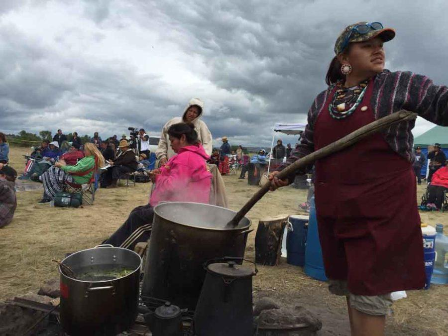 Nantinki Young — known as Tink — stirs large pot of soup for protesters gathered along the banks of the Cannonball River in North Dakota. (William Yardley/Los Angeles Times/TNS)