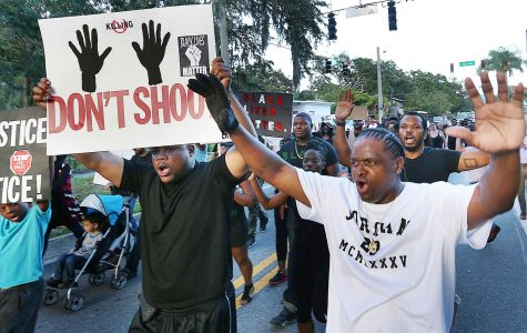 Marchers chant and carry signs in Sanford, Fla., during a Black Lives Matter march and rally on Sunday, July 17, 2016. (Stephen M. Dowell/Orlando Sentinel/TNS)