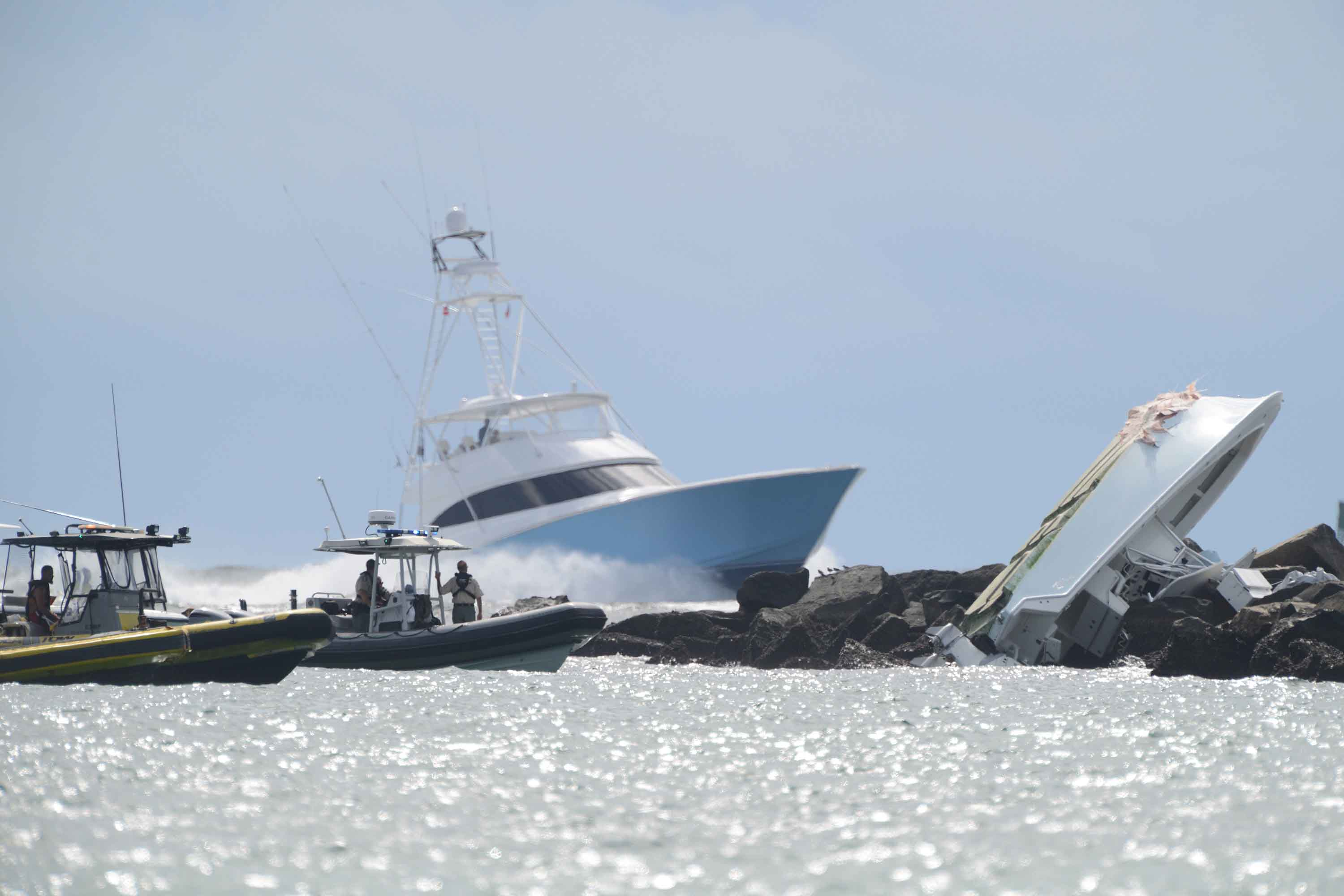 Investigators look over the overturned boat in which Miami Marlins pitcher Jose Fernandez was killed, Sunday, Sept. 25, 2016, in Maimi Beach. (Joe Caveretta/Sun Sentinel/TNS)