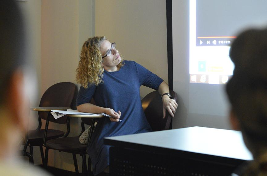 Associate Professor of Spanish Jennifer Smith, of Carbondale, watches a student presentation Tuesday, Oct. 4, 2016, during her Neoclassicism and Romanticism class in Faner Hall. (Autumn Douglas | @autumn__douglas)