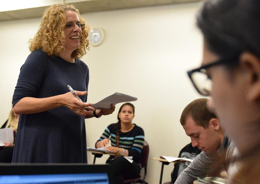 Associate Professor of Spanish Jennifer Smith, of Carbondale, speaks with a student Tuesday, Oct. 4, 2016, during her Neoclassicism and Romanticism class in Faner Hall. (Autumn Douglas | @autumn__douglas)