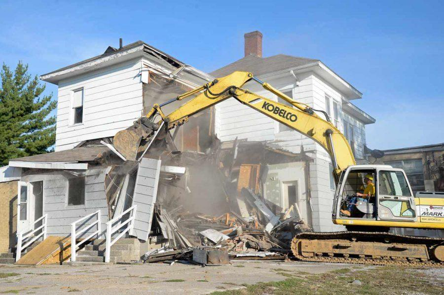 Kevin Wheetley operates a crane Thursday, Oct. 6, 2016, to demolish apartments adjoining a closed business Jeffrey Laundromat; 311 W. Main St. in Carbondale.