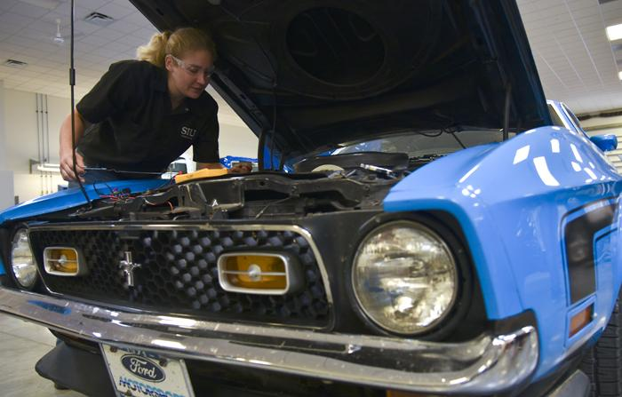 "Alicia Johnston, a senior from Dunlap studying automotive technology, works on a car Friday, Oct. 7, 2016, in the Automotive Technology building. ""I realized I wanted to do something where I felt like I made a difference everyday,"" Johnston said. ""So I picked the automotive industry.""  (Autumn Suyko 