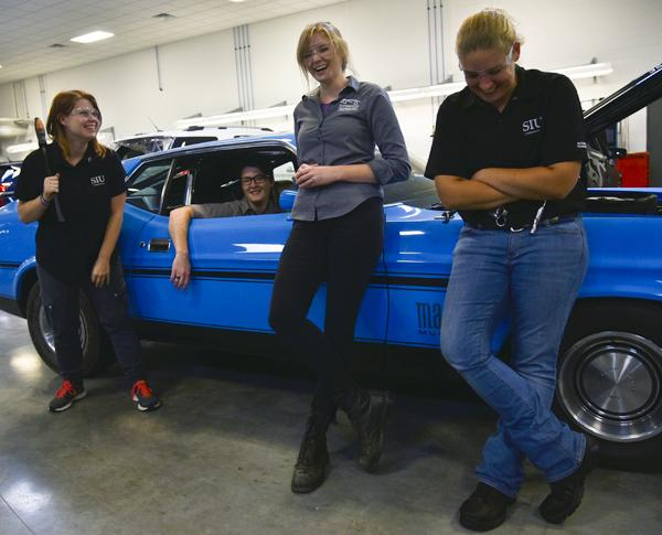 "From left: Alli Giblin, of Gilberts, Melissa Vanderwater, of Plainfield, assistant instructor of automotive technology Jessica Suda and Alicia Johnston, of Dunlap, stand for a portrait Friday, Oct. 7, 2016, in SIU's Automotive Technology building. The three students are seniors in SIU's Automotive Technology program. ""I realized I wanted to do something where I felt like I made a difference everyday,"" Johnston said. ""So I picked the automotive industry."" (Autumn Suyko 