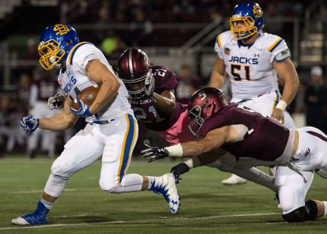 Jackrabbit junior running back Brady Mengarelli (44) is tackled by Saluki junior safety Ryan Neal (21) and senior inside linebacker Chase Allen (5) during the first half of the Salukis' 45-39 loss to South Dakota State on Saturday, Oct. 8, 2016, at Saluki Stadium. (Jacob Wiegand | @JacobWiegand_DE)