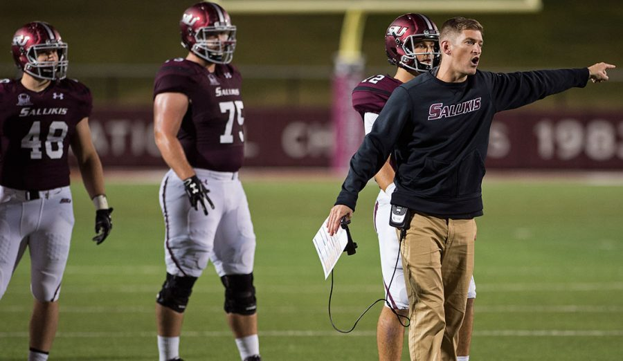 Saluki+football+coach+Nick+Hill+confronts+a+referee+during+the+Salukis%27+45-39+loss+to+South+Dakota+State+at+Saluki+Stadium+while+junior+offensive+lineman+Austin+Olsen+looks+on.