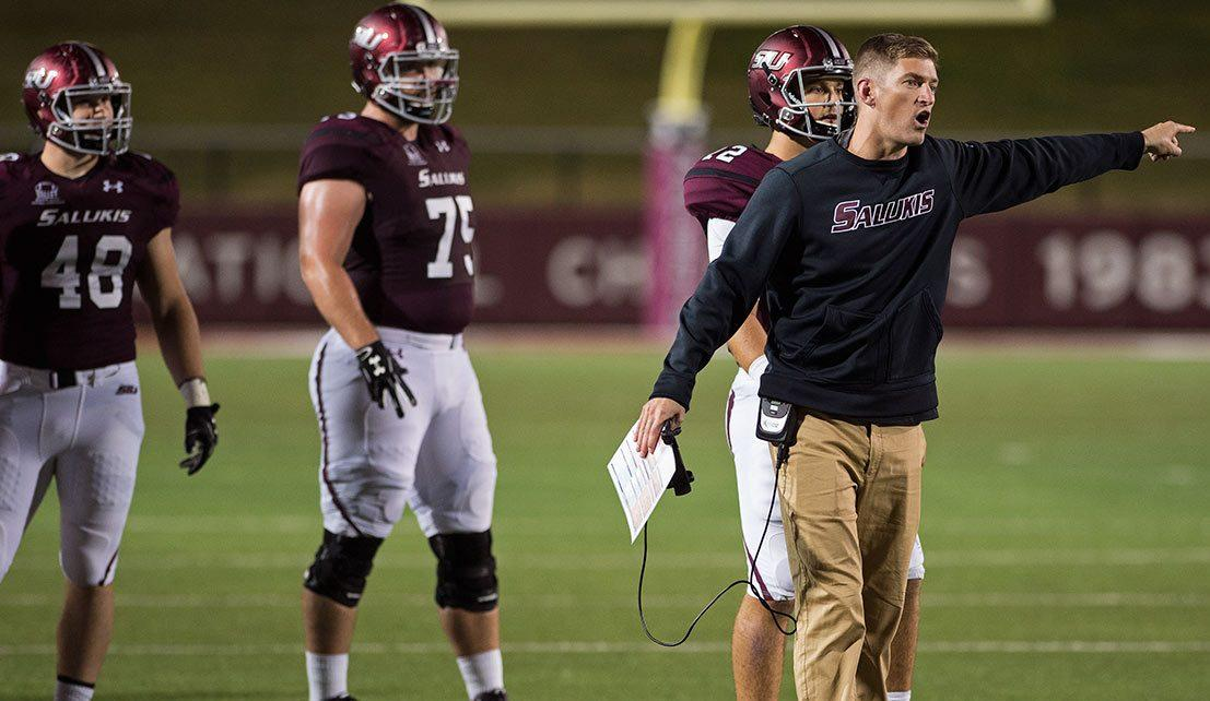 Saluki football coach Nick Hill confronts a referee during the Salukis' 45-39 loss to South Dakota State at Saluki Stadium while junior offensive lineman Austin Olsen looks on.