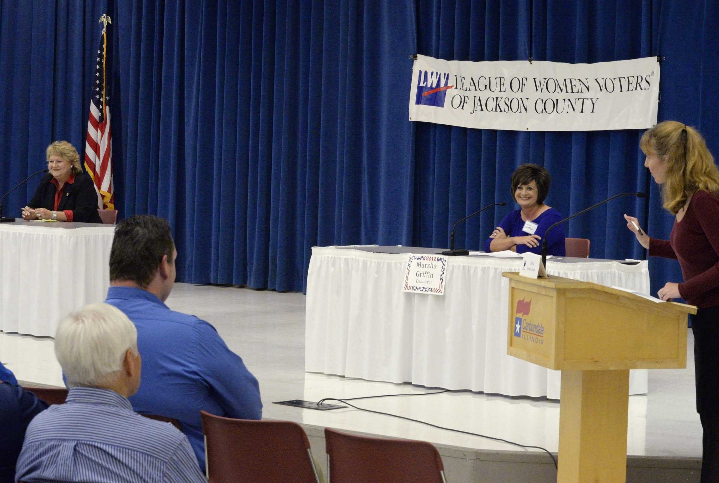 Forum moderator Laura Van Abbema, right, explains some ground rules for answering questions to Republican Rep. Terri Bryant, left, and Democratic challenger Marsha Griffin, center, both candidates for the Illinois House of Representatives District 115 seat, Friday, Oct. 14, 2016, at the Carbondale Civic Center. (Bill Lukitsch | @lukitsbill)