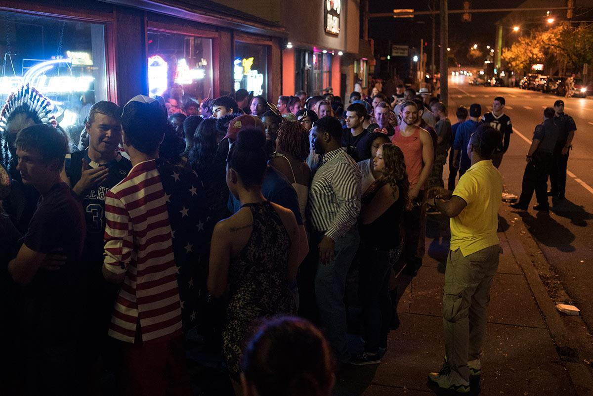 Partygoers line the sidewalk as they wait to get into Stix Bar & Billiards during Unofficial Halloween early Sunday, Oct. 16, 2016, on the Strip in Carbondale. (Jacob Wiegand | @JacobWiegand_DE)