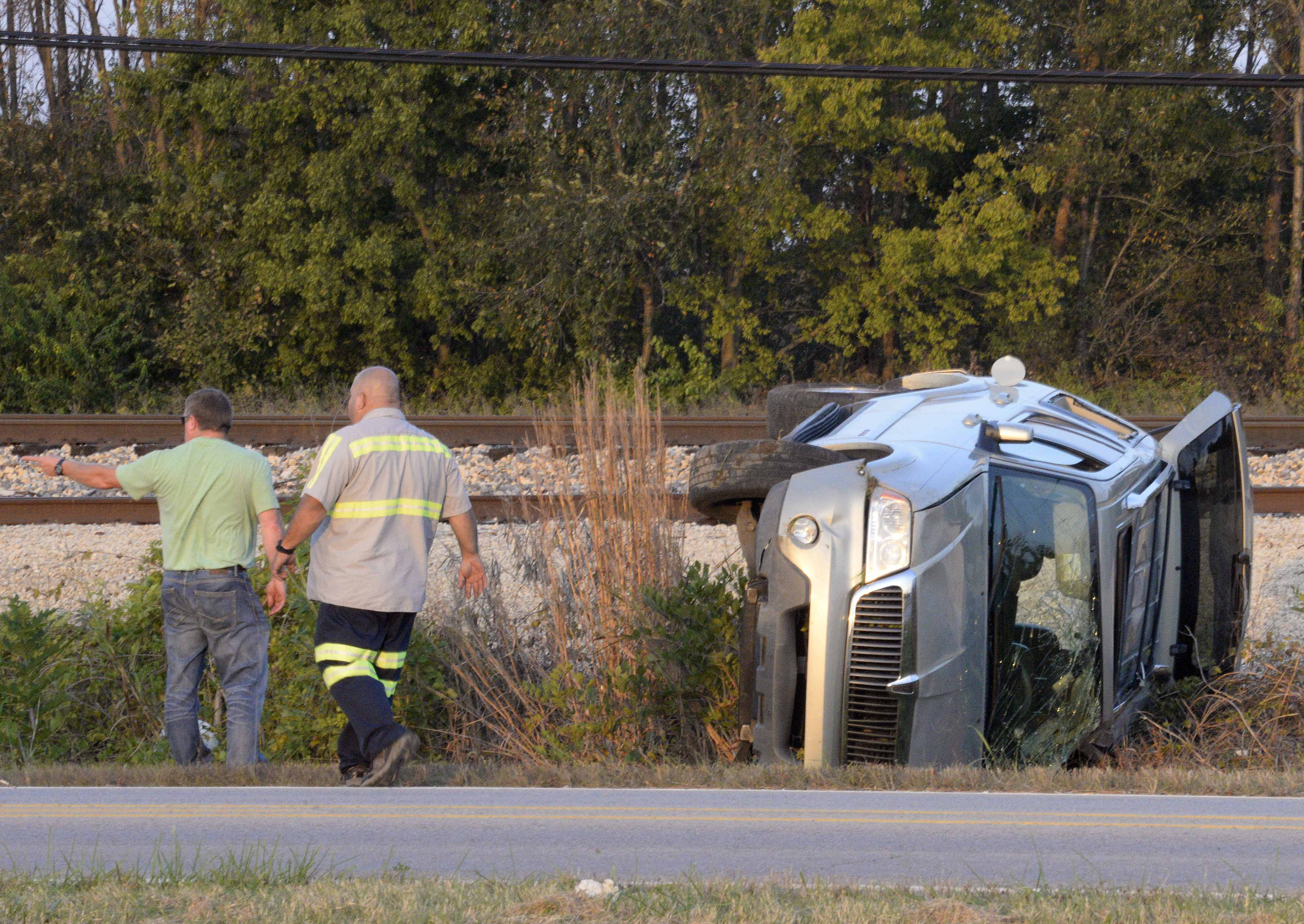 A tow crew responds to a flipped SUV on Sunday, Oct. 16, 2016, in the 1500 block of North Illinois Avenue in Carbondale. (Bill Lukitsch | @lukitsbill)
