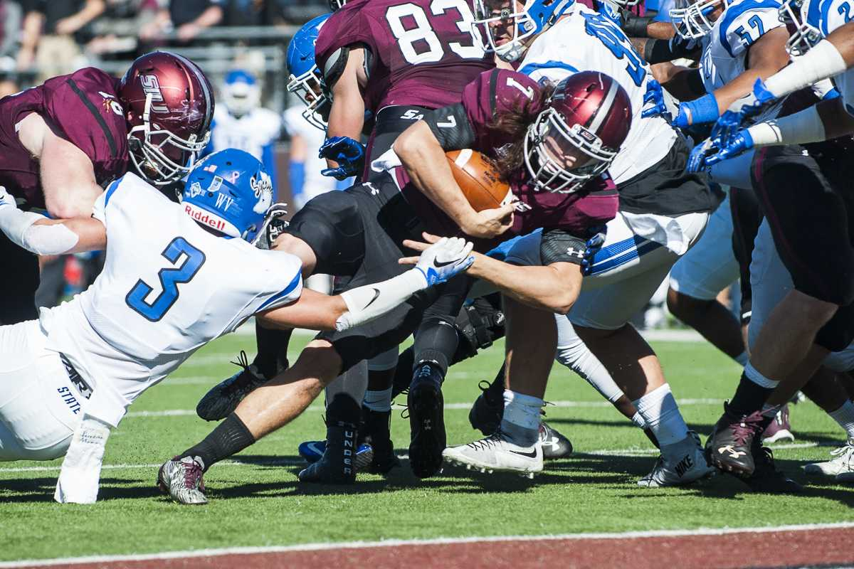 Sophomore quarterback Matt DeSomer (7) works to land a touchdown during the Salukis' homecoming match up against the Indiana State Sycamores on Saturday, Oct. 22, 2016, at Saluki Stadium. SIU lost the game by a score of 22-14. (Ryan Michalesko | @photosbylesko)